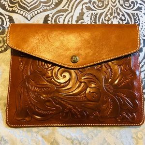 Brand new brown Patricia Nash Leather clutch.